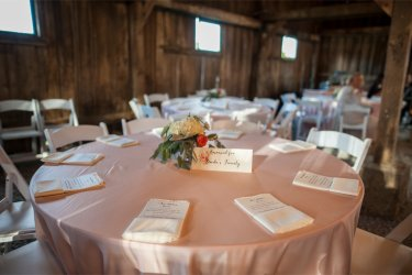 Barn reception at Warrenwood Manor with blush linens and floral centerpieces