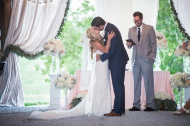 Bride & Groom during their southern glam barn wedding ceremony