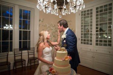 Couple taste their wedding cake
