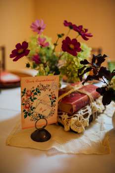 Vintage Wedding Reception Centerpiece with Local Flowers and Old Books