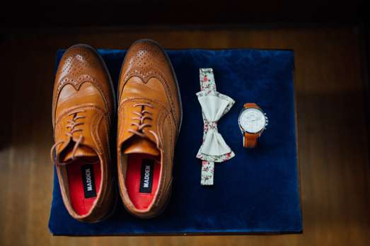 Groom's shoes, bowtie and watch