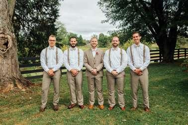 Dapper groomsmen in suspenders