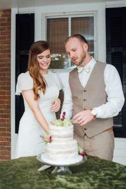 Mr. & Mrs. Cutting their cake during vintage estate wedding