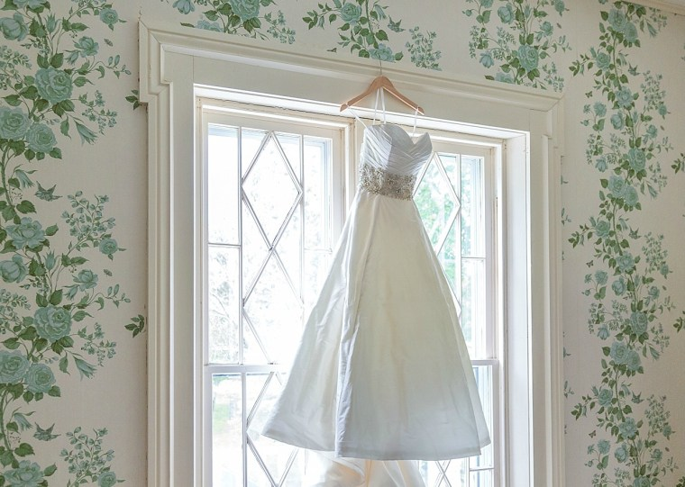 Wedding dress hanging in the Warrenwood Manor Bridal Suite, Photo by Kevin & Anna Photography