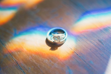 Wedding rings in beam of light at Warrenwood