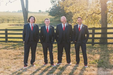 Groom and Groomsmen dressed in Navy at summer farm wedding