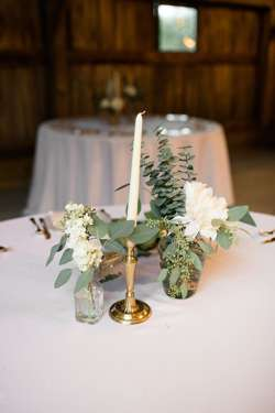Bud vase centerpieces with white florals and eucalyptus at southern barn wedding