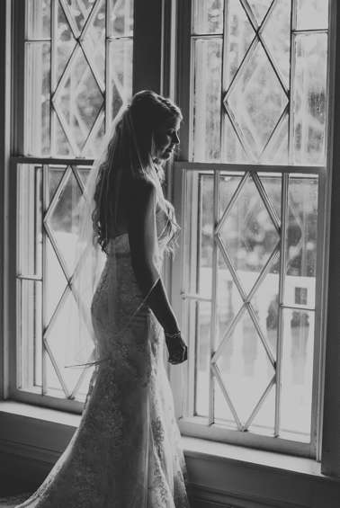 Country Rustic Bride in mermaid dress train in historic Warrenwood Manor, a Kentucky wedding venue.