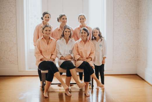 Bridal party in monogrammed button downs and leggings