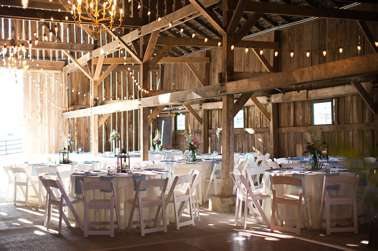 Barn wedding reception with chandeliers