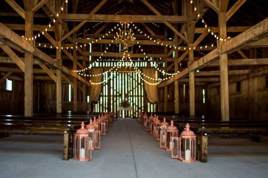 Barn ceremony with lanterns and bench seating