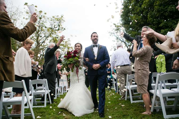 Flower petal toss as Bride & Groom exit their fall outdoor wedding