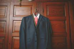 Navy suit hanging in Warrenwood Groom's Quarters