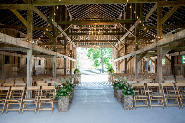 Rustic barn ceremony setup
