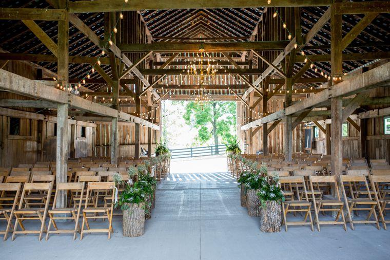 Rustic barn ceremony setup