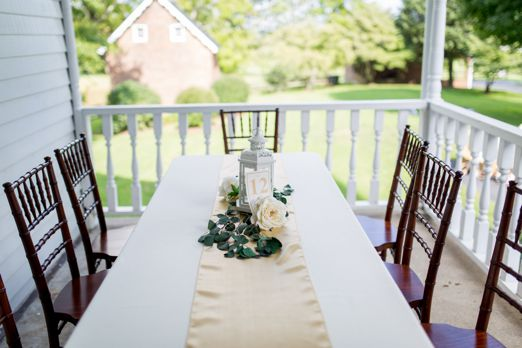 Ourdoor wedding recpetion tablescape with runner, lantern and florals