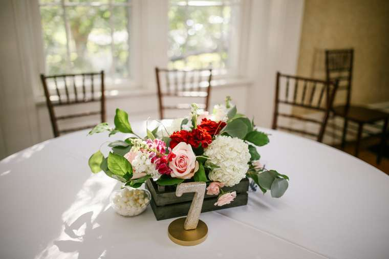 White, red and pink floral centerpiece, rustic glam. Photo by Daring Tales of Darling Bones