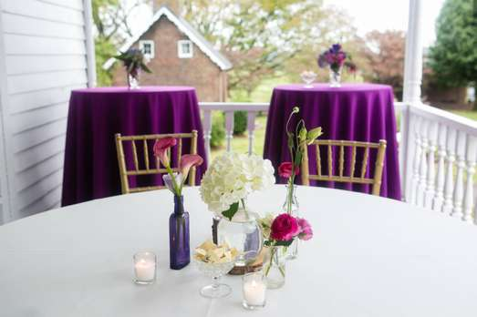Clear & purple bud vases with white & purple booms centerpiece. Doug Smith Designs & Events. Hilly Photography.