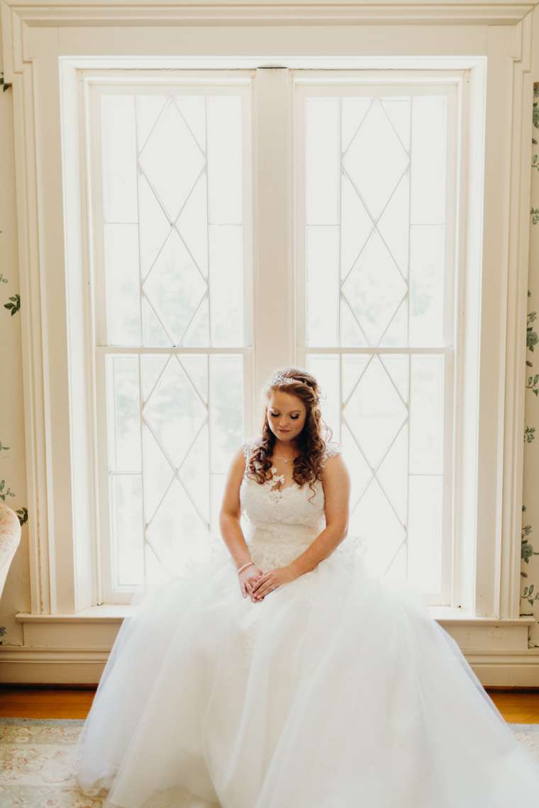 Bride in white ball gown with illusion neck line
