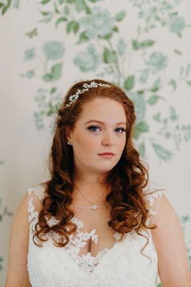 Bride against antique wall paper in Warrenwood Bridal Suite