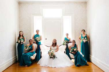 Bridal party in teal bridesmaid dresses in Kentucky mansion