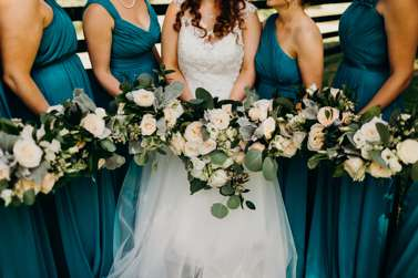 Neutral mixed wedding bouquets with teal bridesmaid dresses
