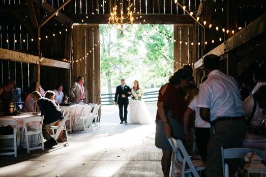 Bride entering traditional romantic wedding ceremony in Warrenwood barn