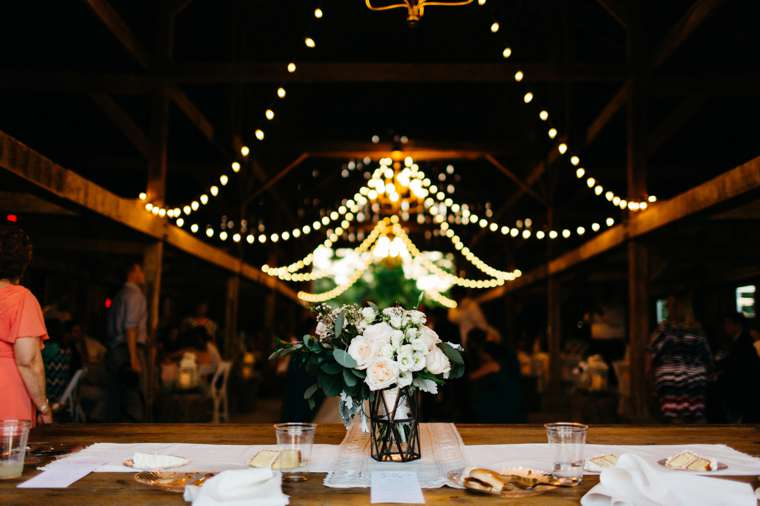 Refined rustic wedding barn with chandeliers and string lights