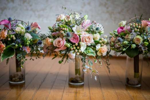 Vibrant bridal bouquet with pink, peach and blue by Carol Smith Botanical Styles, Photo by Jessica Moore Photography