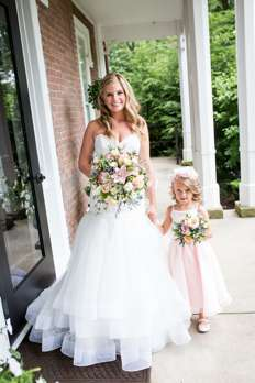 Bride and flower girl at Warrenwood Manor, a central Kentucky wedding venue