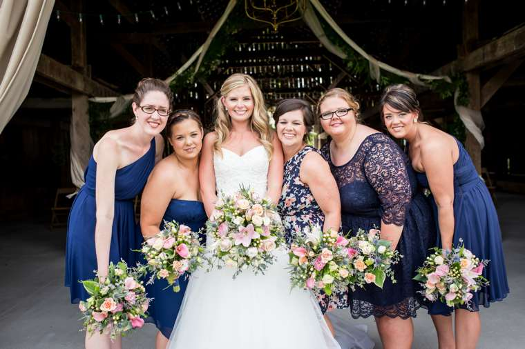 Bridal party dressed in navy blue, different dresses but same color