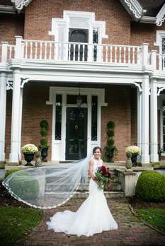 Bride in front of gothic-style mansion in Danville, KY