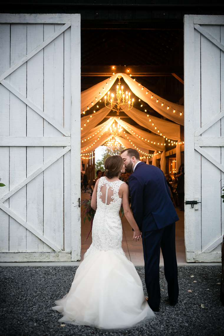 Couple enter rustic glam wedding reception at Warrenwood Manor