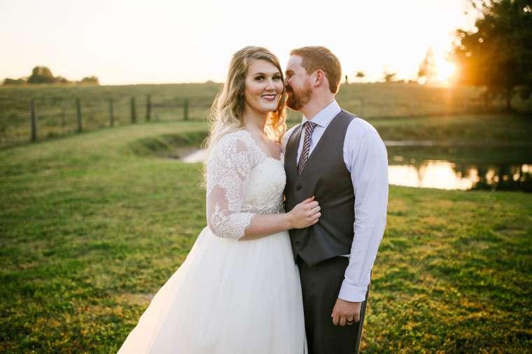 Kentucky farm wedding, bride with 3/4 length sleeve dress and groom in grey