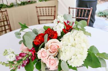 Floral centerpieces with red, pink and white