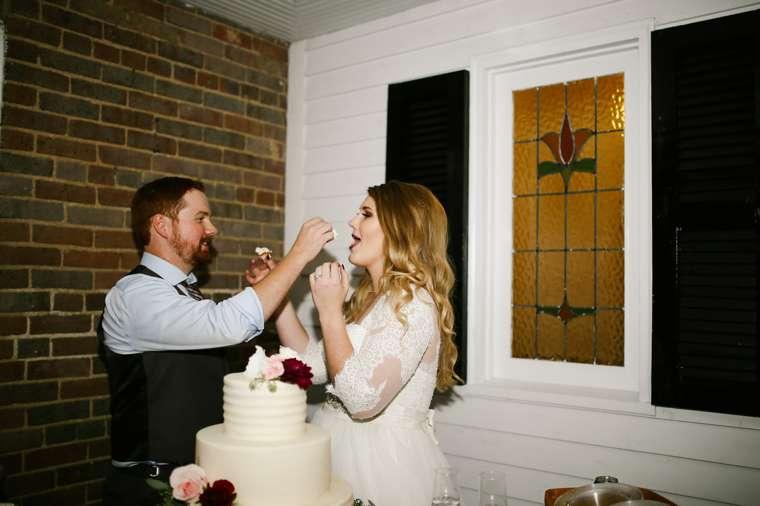 Cake cutting at rustic elegant fall wedding