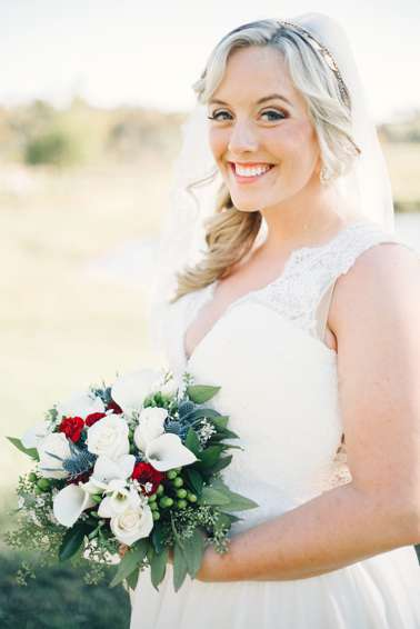 Bride with red, white and blue bridal bouquet