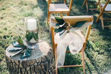 Magnolia leaf wedding ceremony decor | Chair backs and aisle decoration