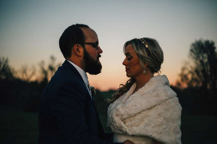 Sunset couple's portrait at late fall farm wedding