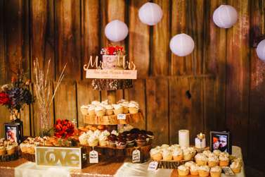 Rustic dessert display at fall barn wedding reception