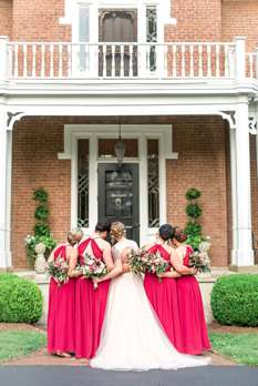 Bridal party dressed in long red dresses for summer KY wedding