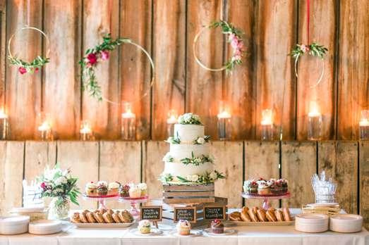 Romantic dessert table with three-tier wedding cake