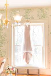 Wedding dress hanging in Warrenwood Bridal Suite