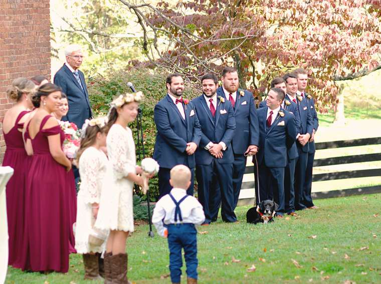 Wedding party waiting for bride to enter fall outdoor ceremony