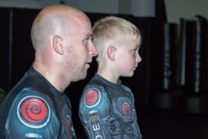 A photo of a man and his son from the blog post A Parent's Guide to helping their child progress in martial arts