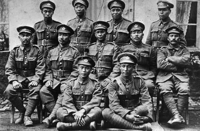 Japanese Canadians of the Fighting Tenth battalion, 1916. Back row, L-R: Otokichi Onishi, unidentified, Nuinosuke Okawa, Tsunekichi Kitagawa. Middle row: Masumi Mitsui, Chikara Fujita, Masaru Nishijima, Toraki Matsumura, Masajiro Shishido. Front row: Tsunejiro Kuroda, Kumakichi Oura. NNM 2010.23.2.4.551