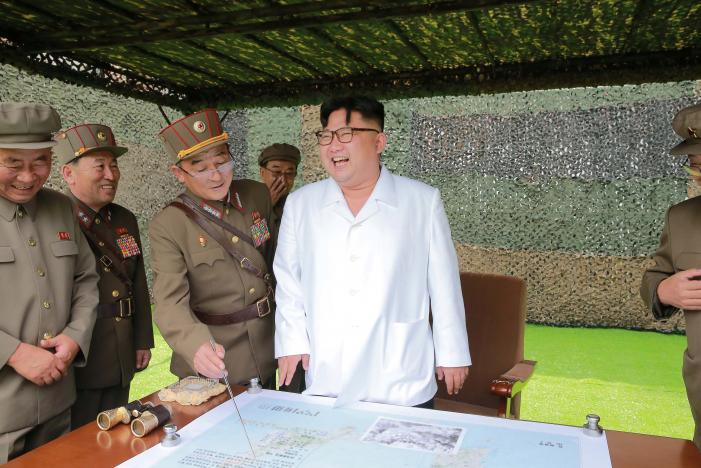FILE PHOTO - North Korean leader Kim Jong Un provides field guidance during a fire drill of ballistic rockets by Hwasong artillery units of the KPA Strategic Force, in this undated photo released by North Korea's Korean Central News Agency (KCNA) in Pyongyang September 6, 2016. KCNA/Files via Reuters