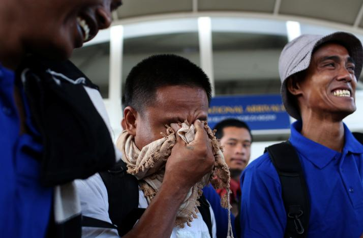 Some of the 26 Asian sailors released after being held captives by Somalia pirates for more than four years become emotional as they arrive at the Jomo Kenyatta International Airport in the capital Nairobi, Kenya