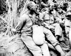 """""""The March of Death."""" Along this March [on which] these prisoners were photographed, the men had their hands tied behind their backs, and were beaten, some to death by their captors. The Bataan Death March required 75,000 Americans and Filipinos to march approximately 65 miles, in April of 1942. From Mariveles to San Fernando they marched. Some 3,000 men died during this forced march. Later, they were transported by train to Camp O'Donnell where some 27,500 prisoners died."""" NARA photo"""