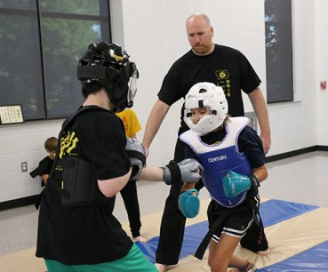 kids spar in an Open Hand karate class Cedar Rapids